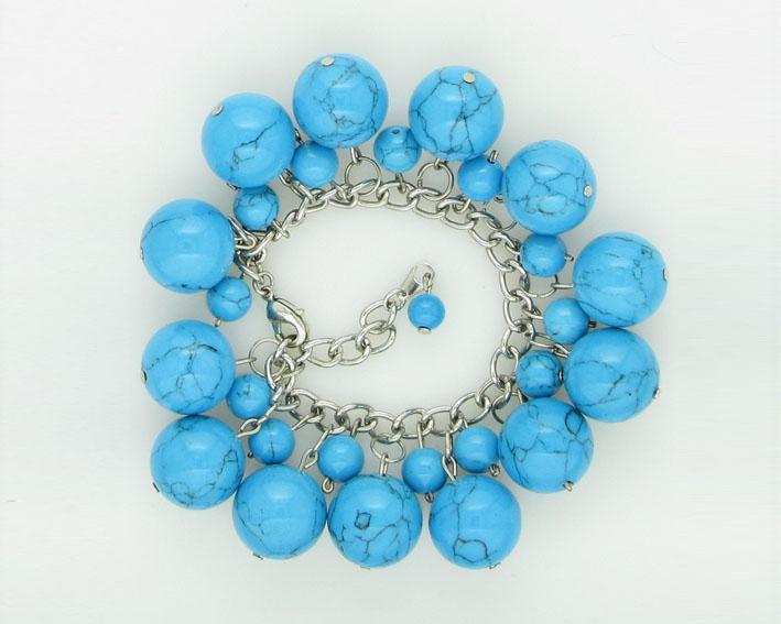 Красивые украшения из камней яркого небесно-голубого, голубовато-синего и голубовато-зеленого...